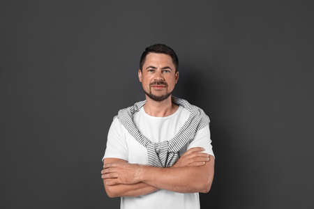 Portrait of handsome man on dark background Banco de Imagens