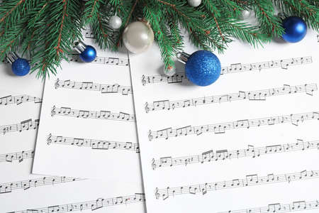 Flat lay composition with Christmas decorations on music sheets Stock Photo