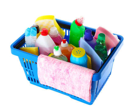Shopping basket with different detergents and rag on white background Imagens