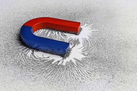 Magnete a ferro di cavallo rosso e blu con limatura di ferro su sfondo bianco