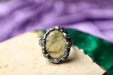 Beautiful silver ring with prehnite gemstone on textured surface