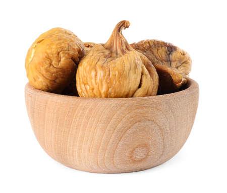 Wooden bowl of dried figs on white background