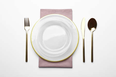 Elegant table setting on white background, top view
