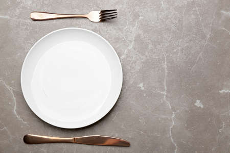 Elegant table setting on marble background, top view. Space for text