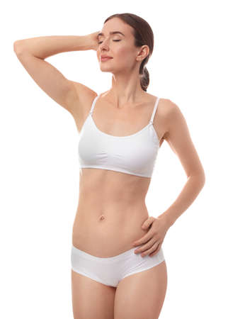 Beautiful woman in underwear on white background