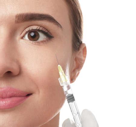 Beautiful woman getting facial injection on white background, closeup. Cosmetic surgery Фото со стока