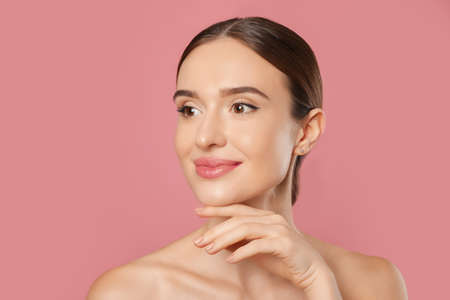 Beautiful woman with perfect smooth skin on pink background Stock Photo