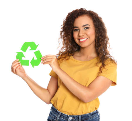Young African-American woman with recycling symbol on white background
