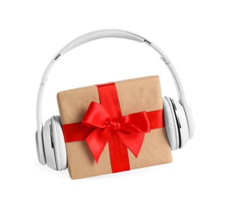 Gift box with headphones isolated on white. Christmas music concept Stock Photo