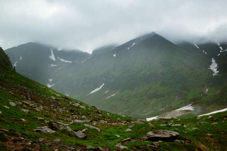 Picturesque view of beautiful foggy mountains and cloudy sky
