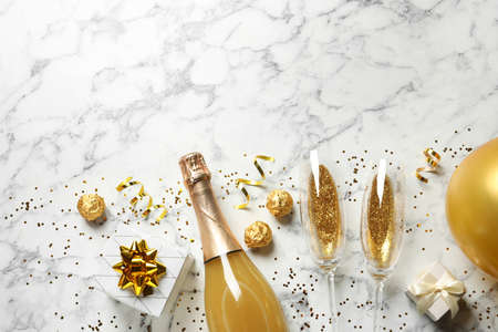 Flat lay composition with bottle of champagne for celebration on white marble background. Space for text Stock fotó