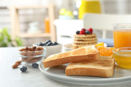 Delicious breakfast with toasted bread served on light table indoors Reklamní fotografie