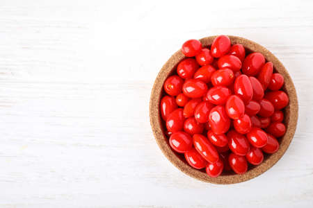 Fresh ripe goji berries in bowl on white wooden table, top view. Space for text Stok Fotoğraf