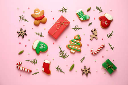 Flat lay composition with Christmas decorations on pink background