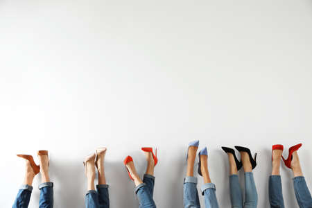 Young women in elegant shoes on white background, closeup Stockfoto