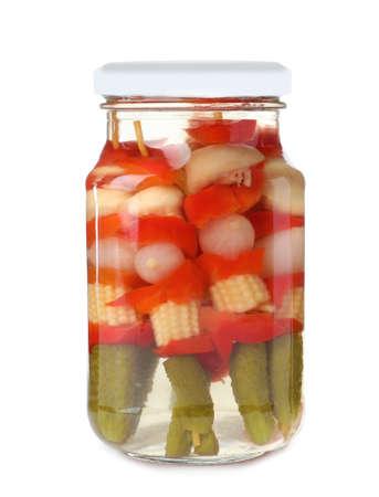 Jar with pickled vegetables on white background Standard-Bild