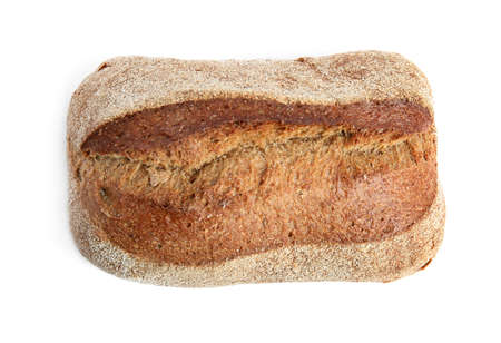 Loaf of fresh bread on white background, top view