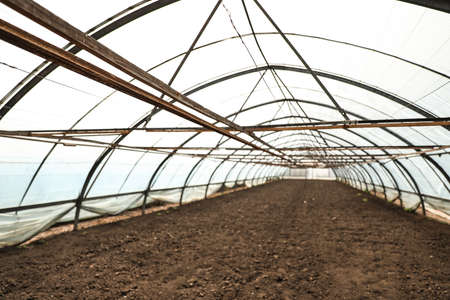 Large agricultural greenhouse prepared for seed sowing Reklamní fotografie