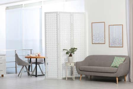 Modern folding screen in stylish room interior 写真素材