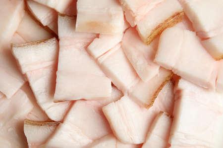 Slices of pork fatback as background, closeup Imagens