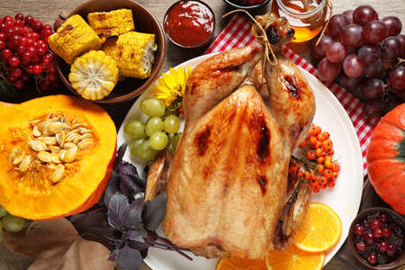 Flat lay composition with turkey on wooden background. Happy Thanksgiving day Stock Photo