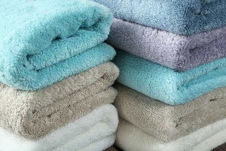 Pile of different soft terry towels, closeup