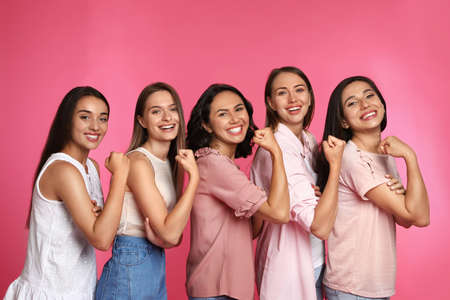 Happy women posing on pink background. Girl power concept Stock Photo