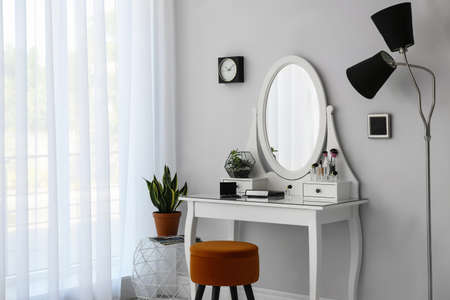 Dressing table with mirror in stylish room interior