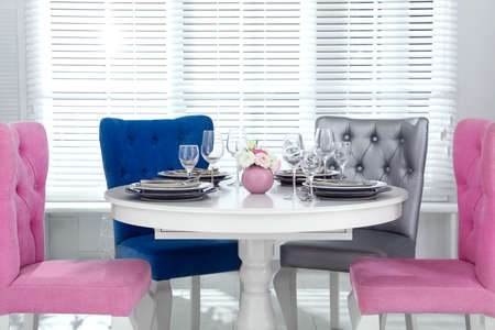 Elegant dining room interior with stylish chairs and table