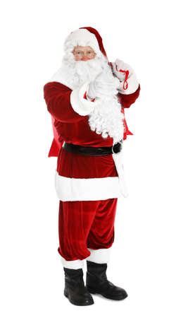 Authentic Santa Claus with bag full of gifts on white background