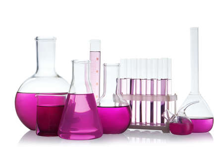 Laboratory glassware with purple liquid on white background