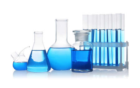 Set of laboratory glassware with blue liquid on white background Stok Fotoğraf