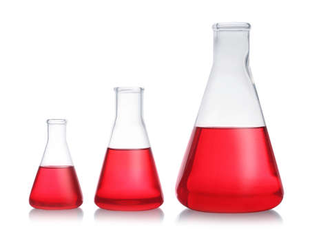 Conical flasks with red liquid on white background. Laboratory glassware