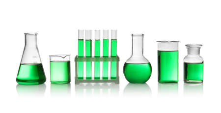 Laboratory glassware with green liquid on white background Stok Fotoğraf