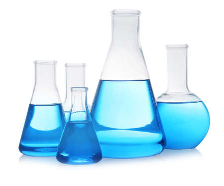 Florence and conical flasks with blue liquid on white background. Laboratory glassware Stok Fotoğraf