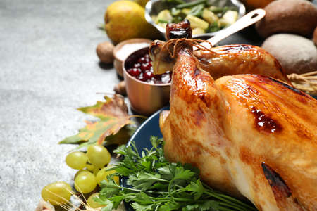 Composition with delicious turkey on grey background, closeup. Happy Thanksgiving day Фото со стока