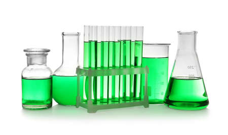 Laboratory glassware with green liquid on white background Reklamní fotografie