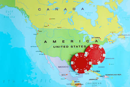 Red casino chips near USA on world map, top view Stok Fotoğraf