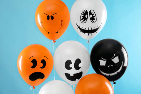 Color balloons for Halloween party on blue background