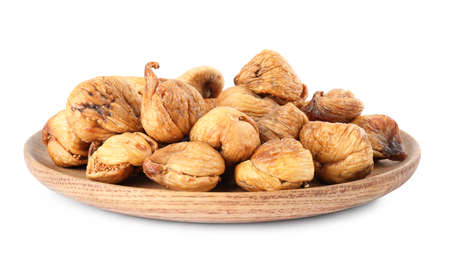 Wooden plate of dried figs on white background Reklamní fotografie
