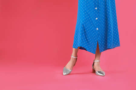 Woman in stylish shoes on pink background. Space for text