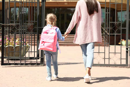 Young mother taking her little child to school outdoors 版權商用圖片