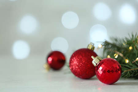 Christmas decorations on table against blurred background, space for text. Bokeh effect