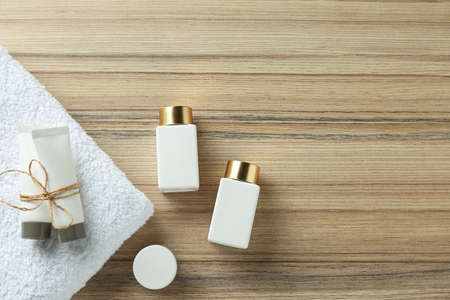 Flat lay composition with cosmetic products on wooden table, space for text. Spa therapy Stock Photo