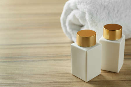 Composition with cosmetic products on wooden table, space for text. Spa therapy Stock Photo