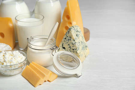 Different delicious dairy products on white table