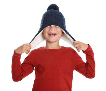 Cute little boy in hat on white background. Winter season Stock Photo