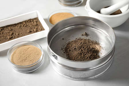 Laboratory equipment for pulverizing and sieving of soil samples on light table Standard-Bild