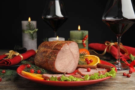 Delicious ham served on wooden table. Christmas dinner Stock Photo