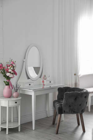Stylish room interior with white dressing table Stok Fotoğraf